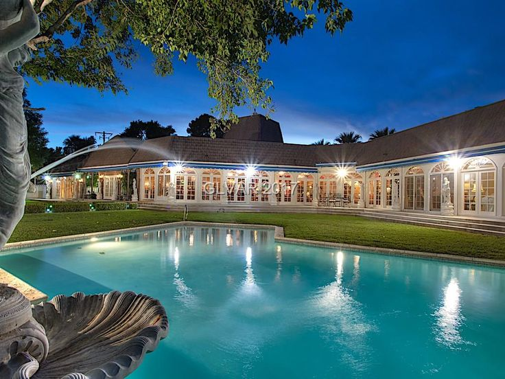 One-of-a-kind mansion, home of Phyllis McGuire, 28,000 sq.ft. property, open floor-plan, ballrooms, cabaret lounge, numerous bars, and sitting rooms. Palatial front room, Arc de Triomphe replica, 45-ft. Eiffel Tower. Chandeliers from Bombay, French decor. Master suite, four room-sized closets. Two formal dining rooms, two chefs kitchens. Hand-carved statues, two swimming pools. Billiard room, tennis court & cafe, garden.