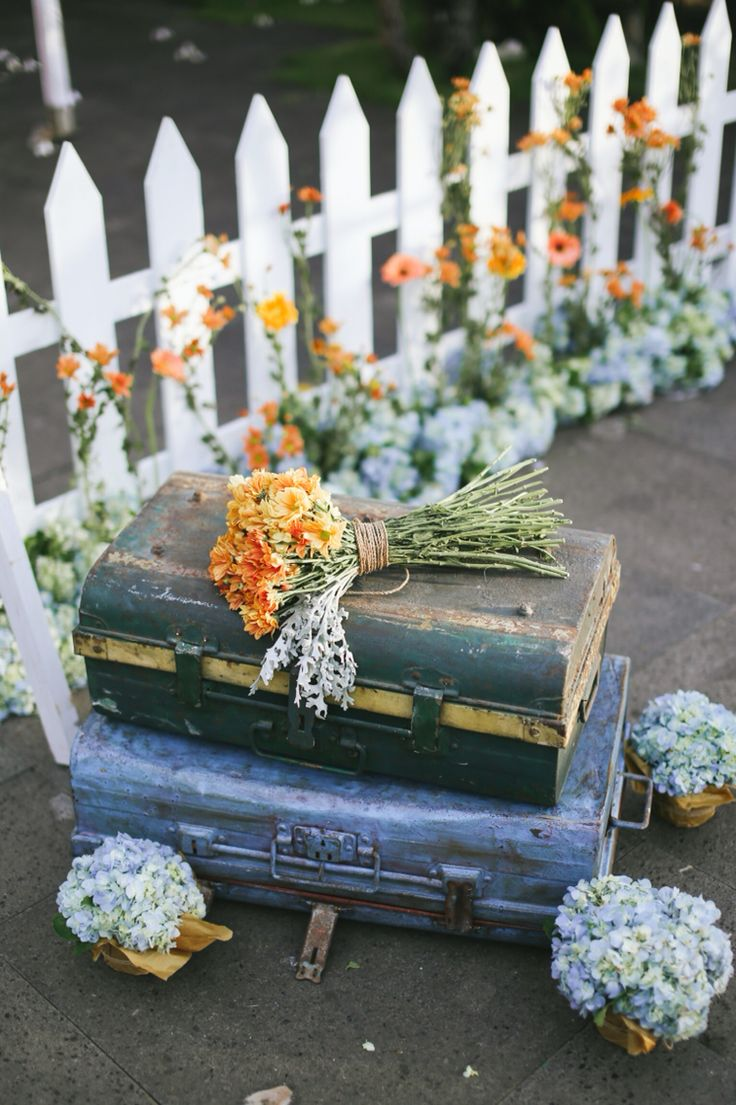 Rustic suitcases with summer flowers bouquet by Amara Universe