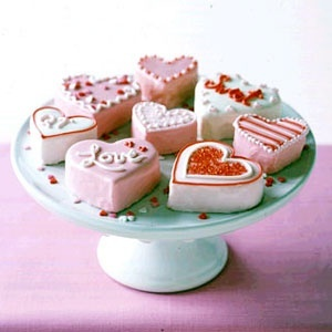 No-Bake Mini Heart Cakes Recipe at WomansDay.com- Easy Dessert Recipes - Woman's Day.  I hope these are like those valentines heart cakes from hostess, cause those are delicious!