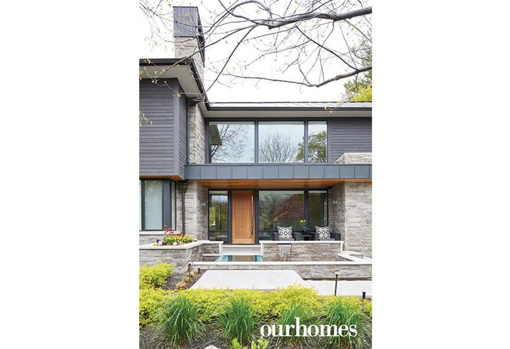 "A steel roof, dry stacked stone, dark siding, warm wood elements and large windows nod to the home's contemporary leanings. The clean lines of the exterior are softened with a warm wood door, waterfall and plenty of garden beds.  See more of this home in ""Modern Style in Olde Oakville"" from OUR HOMES  Oakville Burlington Mississauga, Summer 2017 http://www.ourhomes.ca/articles/build/article/modern-style-in-olde-oakville"