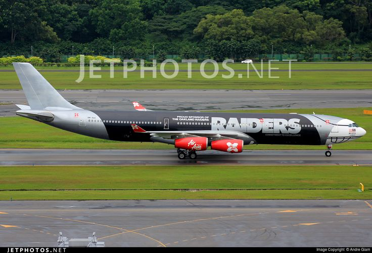 AirAsia X (MY) Historic fleet, Airbus A340-313 9M-XAC aircraft, painted in ''Oakland Raiders'' special colours Jun. 2009 - Jun. 2012, with the stickers ''Proud Sponsor of The Oakland Raiders & Commitement to Excellence'' on the airframe, skating at Singapore Changi International Airport. 08/06/2012. (The plane arrives from Kuala Lumpur, ready to be scrapped off this special livery prior to its lease to Saudi Arabian Airlines).