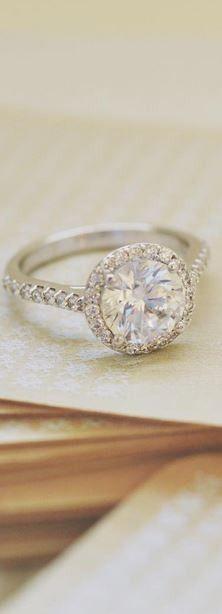 Love this sparkling halo diamond ring.