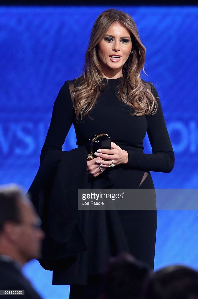 Melania Trump, wife of Republican presidential candidate Donald Trump, stands on stage following the Republican presidential debate at St. Anselm College February 6, 2016 in Manchester, New Hampshire. Sponsored by ABC News and the Independent Journal Review, this is the final televised debate before voters go to the polls for the New Hampshire primary on February 9.