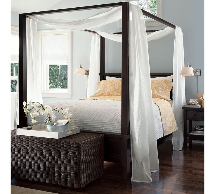"Farmhouse Canopy Bed from Pottery Barn.  ""Canopy"" from two crosswise swags of sheer material, draping slightly with no puddling."