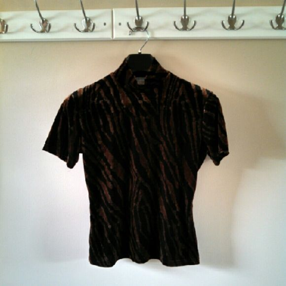 Hold - 1990s Soft Animal Print Short Sleeve Top Black & gold 1990s animal print short sleeve top in excellent condition! Outside feels like velvet. Inner lining. 90% Polyester 10% Spandex. Dry clean only. Firm price. Not currently for sale. Jonden Tops