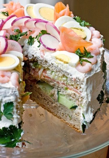 This has got to be the coolest sandwich on the planet. It's basically a sandwich that you eat with a fork. How awesome would this be for a party!? You could make it with the basics (ham and cheese) for a kid's party, or really impress with salmon, cucumbers, radish, boiled eggs, parsley, or anything …
