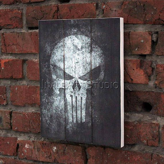 """The Punisher Picture on wood Image transfer Print transfer Wood wall hanging Wood wall art Wood wall decor Wood gift Gamer gift SIZE: 35 x 27 cm 14"""" x 11"""" US$27.00 Materials: wood, acrylic paint, print, waterproof varnish, jute rope. #thepunisher #marvel #skull #thepunisherskull #skullwallart #handmade #pictureonwood #transferonwood #printtransfer #woodwalldecor #woodwallart #woodwallhanging #walldecor #homedecor #interiordesign #loft #gamergift #giftidea"""