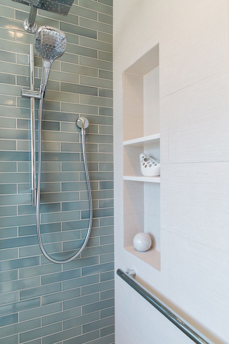 timeless shimmering blueu201d heath tiles face an accent wall in this san