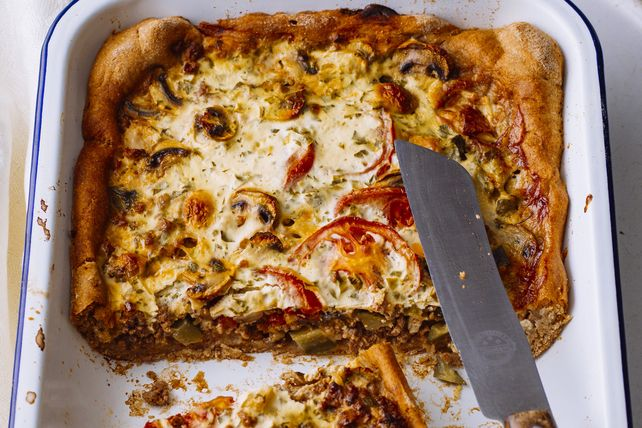 Try a tasty twist on pizza tonight. With ground beef, mushrooms, onions and two cheeses, this one is a real crowd pleaser. Good thing it makes 12 servings!