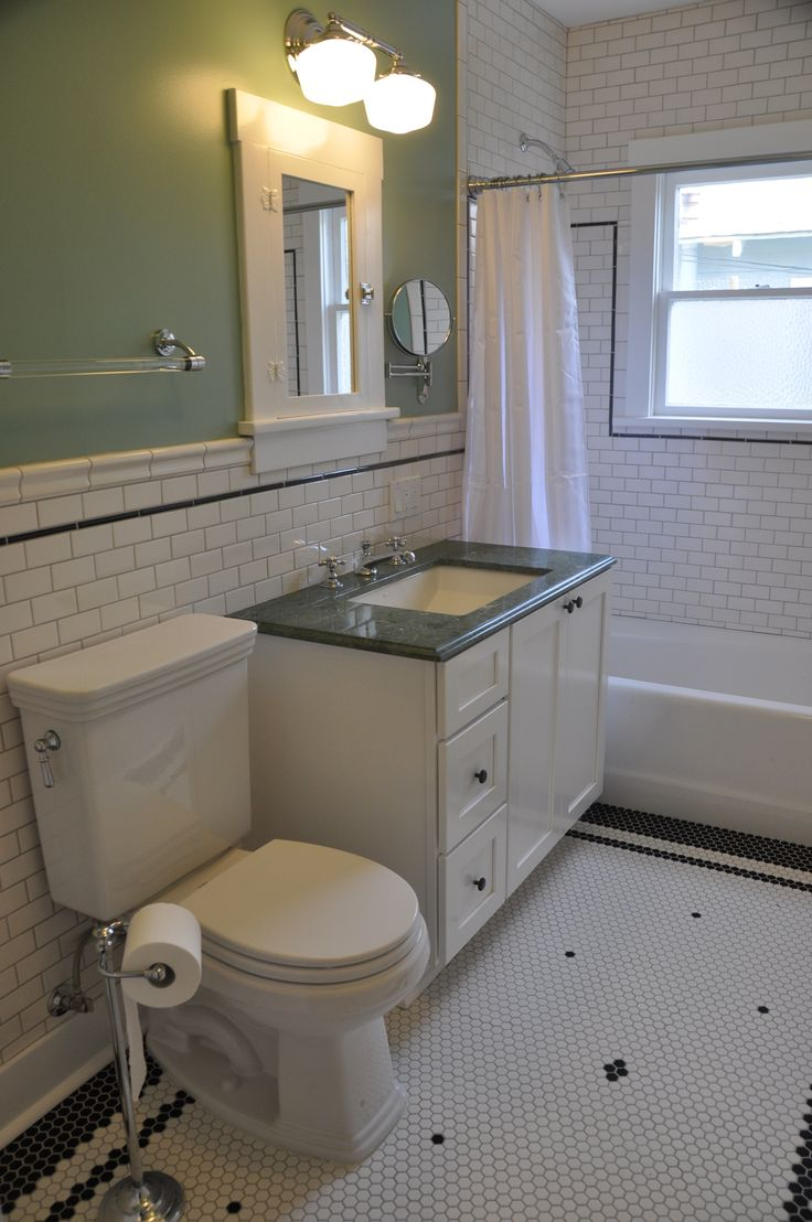 green marble vanity green wall paint white hex floor tile with black tile boarder