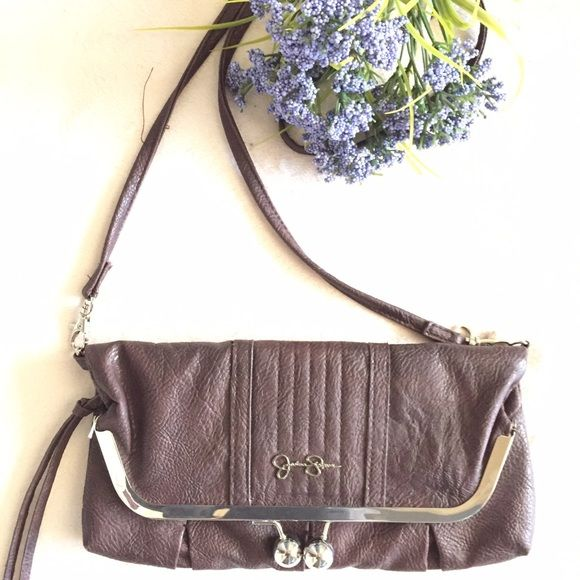 "BOGO50% Jessica Simpson Tiffany Foldover Clutch Brown Jessica Simpson Tiffany foldover clutch. Fabric lining. Vegan. Removable 25"" strap. Dimensions: 11 x 1 x 5. Perfect condition. Jessica Simpson Bags Crossbody Bags"