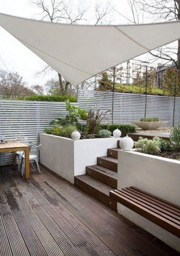 Canopy provides good shelter from the elements.  Nice seating and retaining walls.