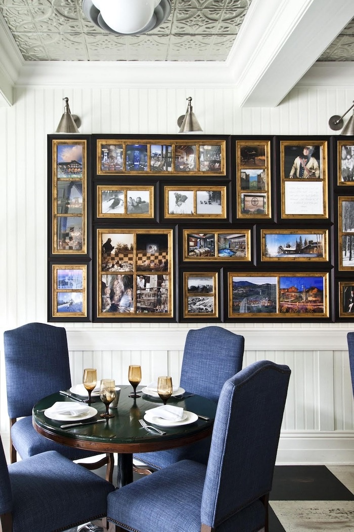 Dining room showing the photo wall and the gilded mullions and liners that was done for the frames. Talisker on Main in Park City. This historic building was renovated.