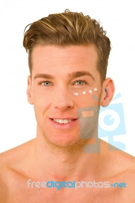 Young Man With Anti Wrinkle Cream No matter where we are we live in the skin package given at birth. To protect is so important