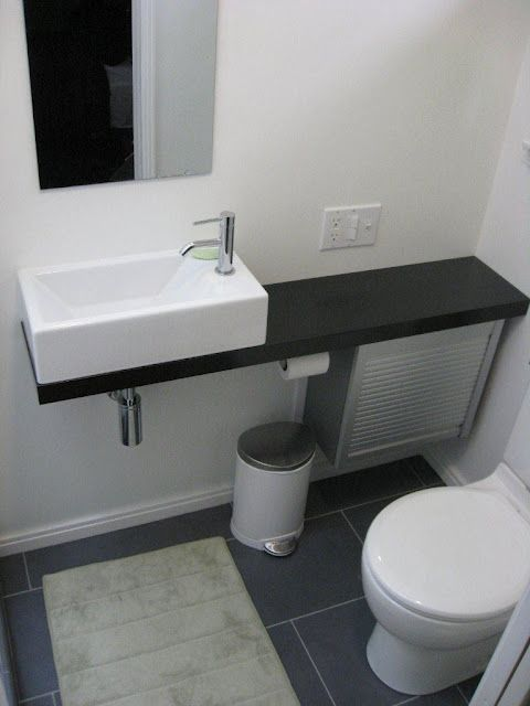 A tiny bathroom is possible with the right fixtures. Turn a closet into a hall bath! Sink found at Ikea.
