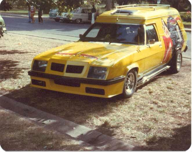 Image from http://www.madmaxmovies.com/forum/storage/madmaxmovies/photos/lastxc/Yellow%20Holden%20Van.jpg.