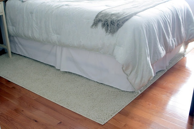 Duct tape the underneath side of two inexpensive area rugs to make a bigger sized rug for cheap!