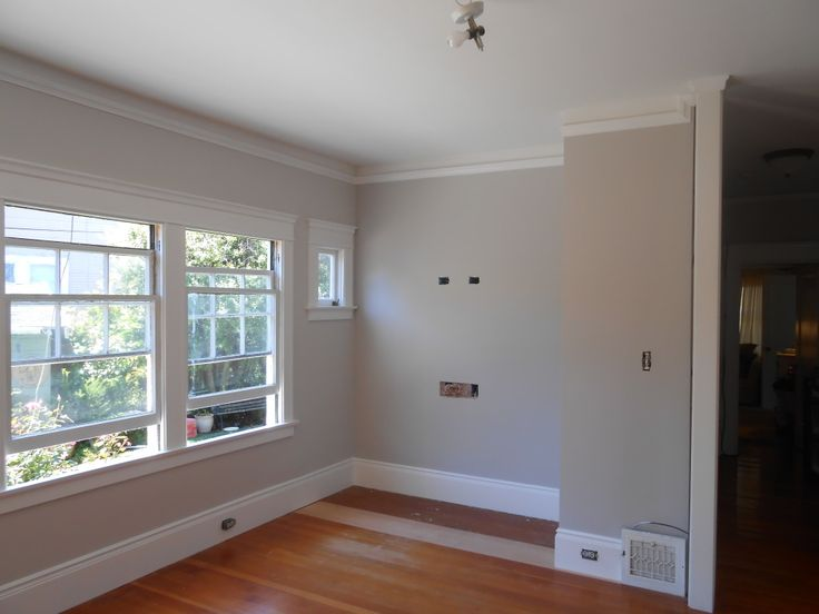 Benjamin Moore Nimbus on walls, BM Simply White on all trim and BM White Heron on ceiling and wall above picture moulding.
