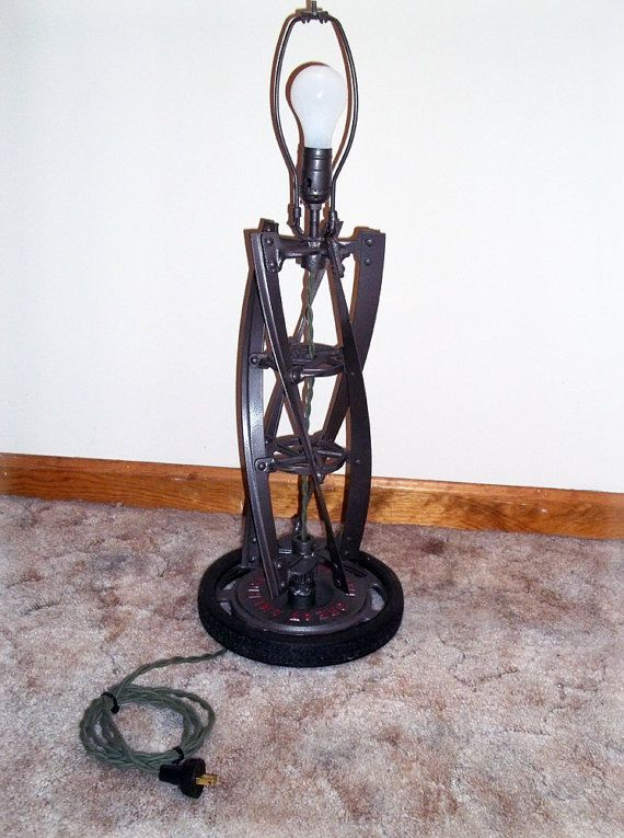 Truly unique table lamp.That finishing touch for your den or farmhouse. Designed from 1950s push lawnmower. This lamp features molded rubber tire base, vintage cloth cord and plug. Matching shade included. Perfect for the guy or girl  who likes to work with tools .