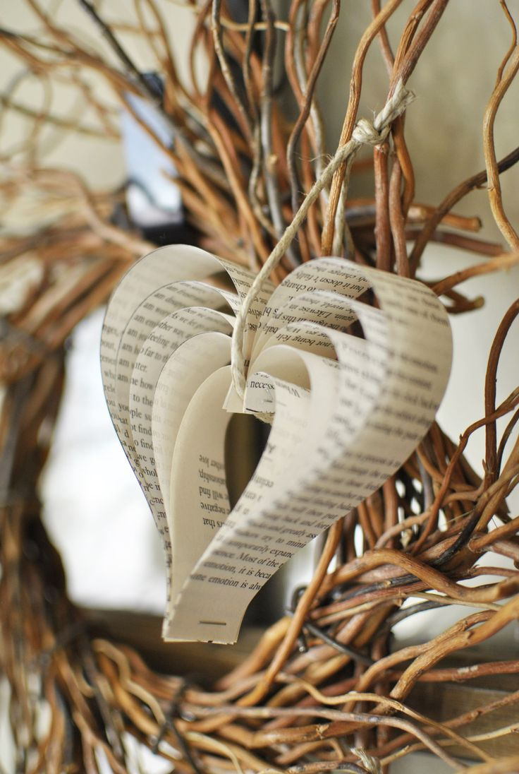 Homemade hearts made from book pages-- I could do these with maps to keep with our map table runners.: