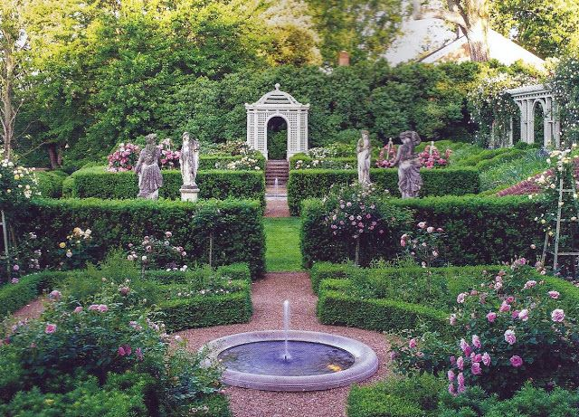 A beautiful, formal rose and boxwood garden in Orange, Virginia, designed by landscape designer Charles Stick