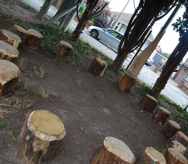 school playground reading circle made from old tree stumps