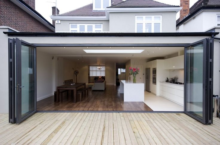 Bi-fold doors. Kitchen running the length of the wall. 2 different styles of floor work surprisingly well.
