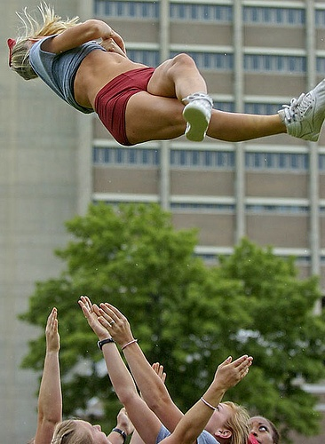 Cheer, Oklahoma college cheerleader in the air, stunt,  collegiate cheerleading moved from Kythoni's Cheerleading: In the Air board http://www.pinterest.com/kythoni/cheerleading-in-the-air/ m.86.15  CHEER #KyFun