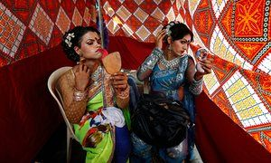Eunuchs apply makeup before Raksha Bandhan festival celebrations in Mumbai