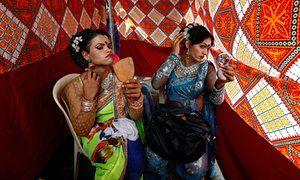 Eunuchs apply makeup before Raksha Bandhan festival celebrations in Mumbai