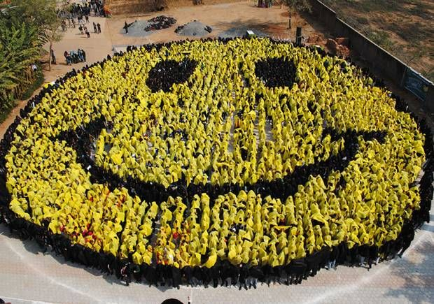 Happy days: Human brain now registers smiley face emoticon as real ...