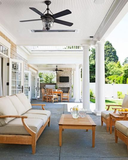 French doors from the home open up onto the terrace, which is outfitted with ceiling fans as well as heaters to extend the outdoor season. - Traditional Home ® / Photo: John Granen / Architect: Paul Moon