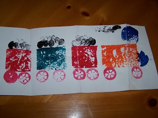 Train prints.  Use different items so that the children can create their own train by making prints with different objects.  (sponges, old spools, corks, forks)