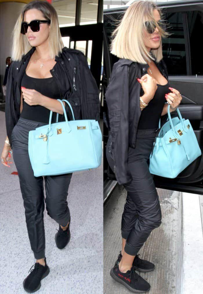 buy popular 2fa3b 919c5 Khloe Kardashian wearing an all-black ensemble with Yeezy x Adidas Boost  350 V2 Sneakers at LAX