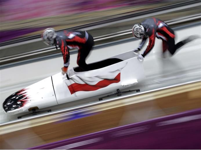 dawid kupczyk of poland pilots a bobsleigh practice run. Black Bedroom Furniture Sets. Home Design Ideas