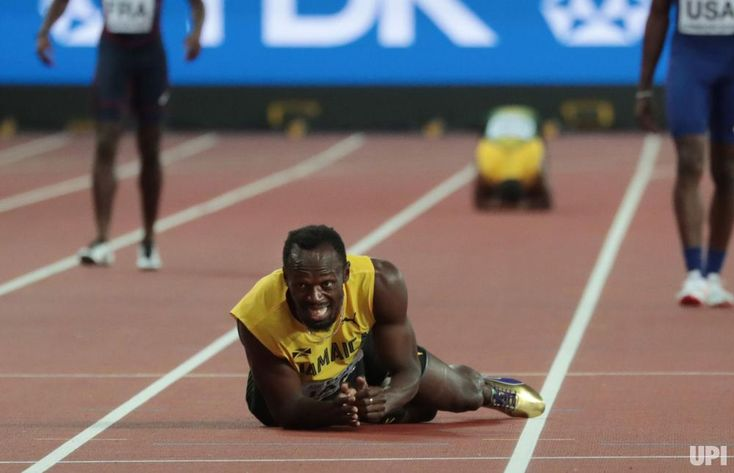 2017 pictures of the year - December 28, 2017:  Jamaican Usain Bolt lies in pain during the men's 4x100 meters relay at the IAAF World Athletics Championships in London on Aug. 12. Bolt cramped and failed to finish in his last race before retirement. File Photo by Hugo Philpott/UPI
