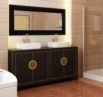 Wood framed mirror over simple Asian vanity