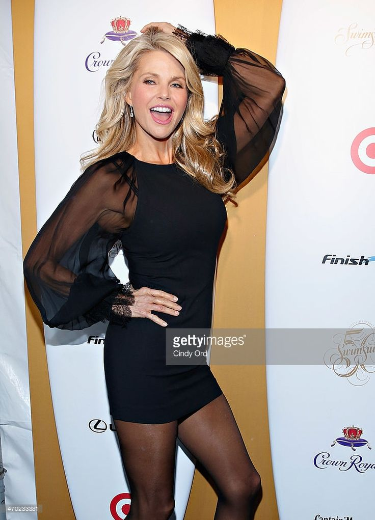 Model Christie Brinkley attends as Captain Morgan White Rum and Crown Royal XO raise a glass to the Sports Illustrated Swimsuit 50 Years of Swim Issue at the Sports Illustrated Swimsuit Beach House on February 18, 2014 in New York City.