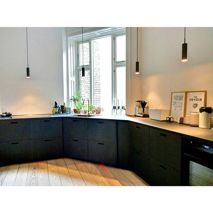 Kitchen / black cabinets and pendant lighting
