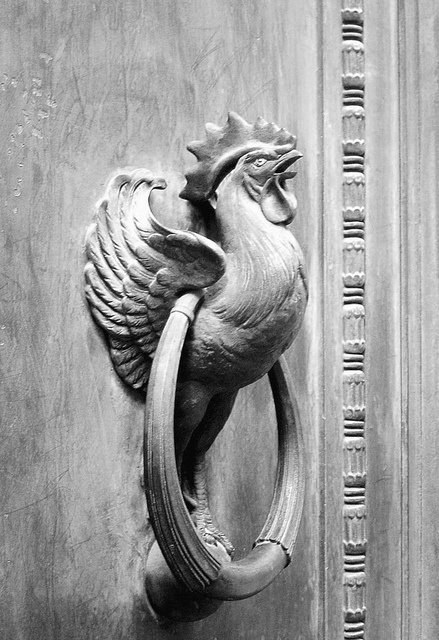 Le Coq Gaulois is one of the national symbols of France and is used for these huge door knockers on a building in the Rue Vivienne which is the back entrance to Bibliothèque Nationale .