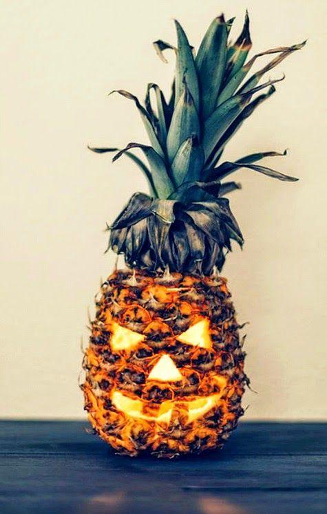 Tee hee...Carved pineapple jack o lantern