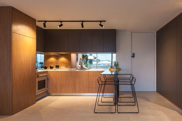 Apartment renovation - Kitchen by LDC. Claremont, Western Australia. #Kitchen #modern #modernkitchen #timber #timberkitchen #style #design  #glass #integrated #kitchendining #smallapartment #apartment #ideas #apartmentideas #tracklighting #lighting #mirror #mirrors #stools