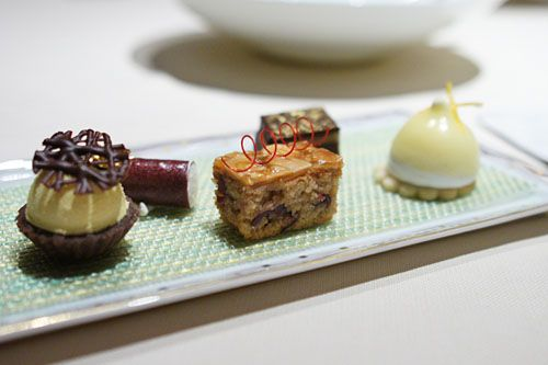 various mignardises: lemon meringue, chocolate-orange brownie, cranberry-almond cake, strawberry and crème fraiche roll, tiramisu.