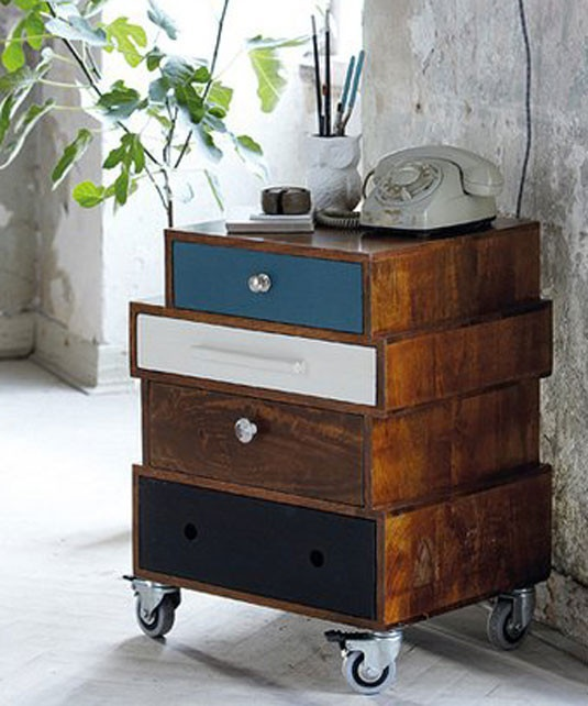 stacked mismatched drawers side table