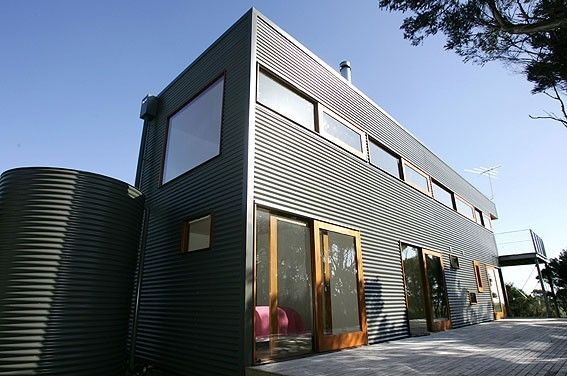 Metal facade cladding: steel - COLORBOND® - BlueScope Steel with wooden trim
