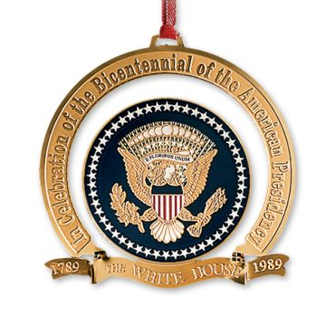 The White House Christmas Ornament for 1989 celebrates the 200th anniversary of the Presidency of the United States with a replica of the official seal of the president.  This familiar emblem accompanies the president on all official occasions.  It decorates the platform where he speaks and it is a familiar feature ...