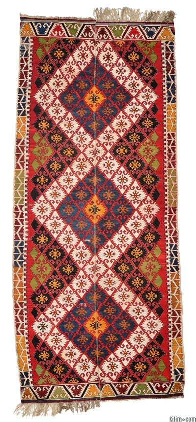 Vintage Sivrihisar kilim area rug around 70 years old. This rarely used piece has vivid colors and is in very good condition. 'Elibelinde' (hands on hips) motifs are used through out this lovely kilim.