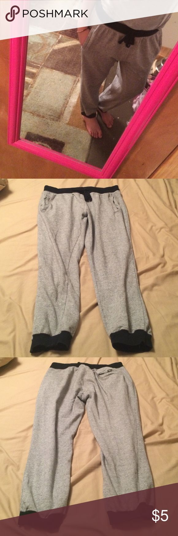 Grey joggers Hollywood grey joggers they say XL but I just tied the string around tighter and they fit wonderfully and I'm a size 28/6-7 small holes in pocket on on the very edge I wore them after the holes used condition price is really reasonable I just need some closet space 💕📦thanks for looking Pants Track Pants & Joggers