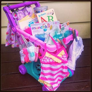 Little Girl baby shower gift; or even a 1st Birthday gift. A play shopping cart, bathing suit, essentials, and books! #SuperThoughtful