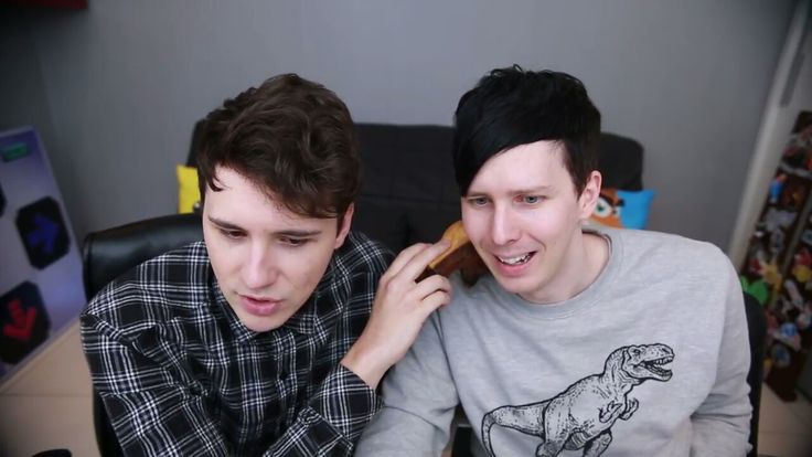 Well I didn't expect THIS on gaming channel xd Dan holding a moose on Phil's shoulder and Phil playing Getting Over It